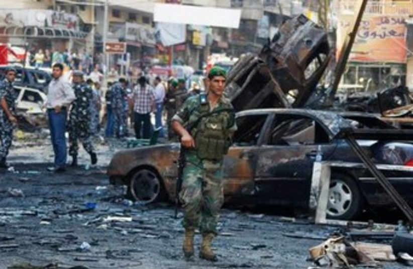 Lebanese soldier at blast site 370 (photo credit: REUTERS)