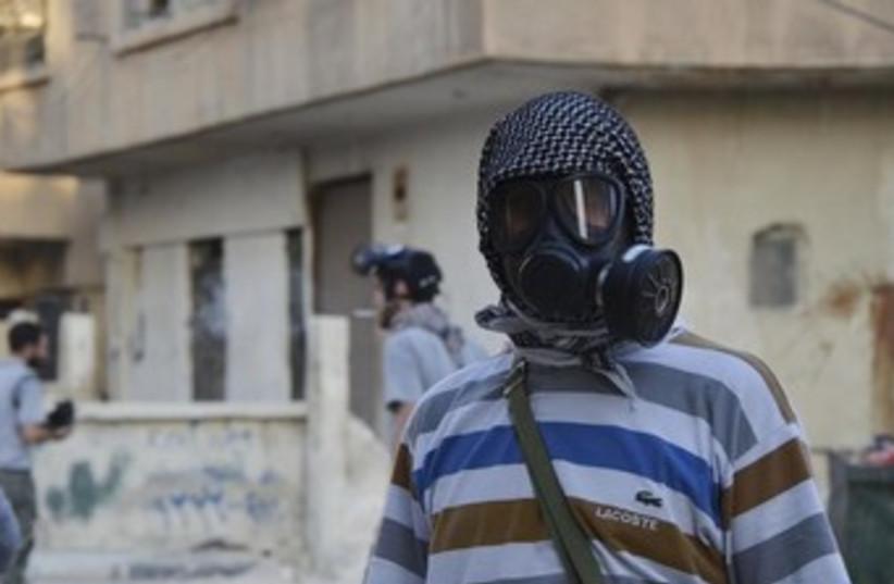 Syiran gas mask 370 (photo credit: REUTERS/Bassam Khabieh )