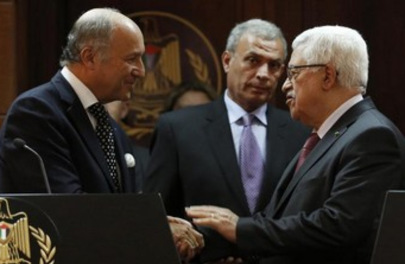 Abbas with French FM Fabius 370 (photo credit: REUTERS/Mohamad Torokman)