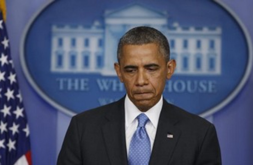 Obama looking sad at White House 370 (photo credit: REUTERS)