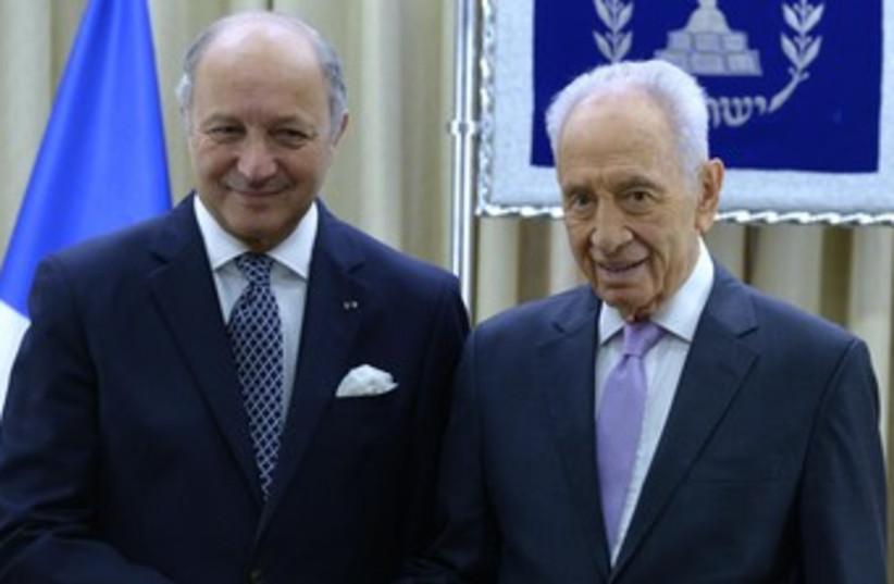 Peres with French FM Laurent Fabius (photo credit: Mark Neiman/GPO)