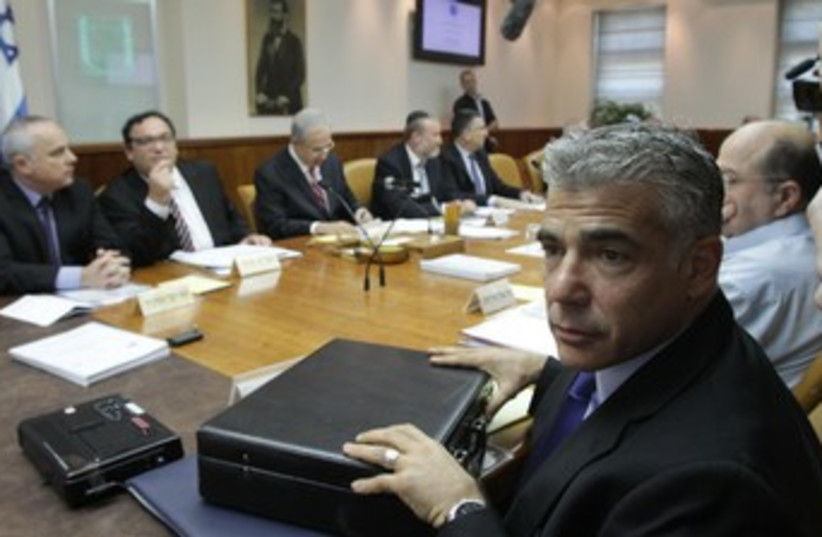 Lapid looking wary 370 (photo credit: Mark Neiman/GPO)