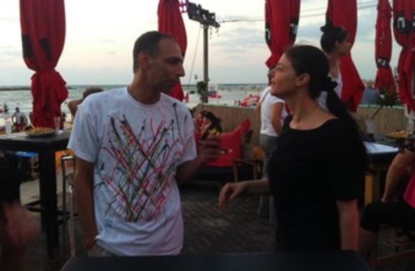 Merav michaeli speaks with man 370 (photo credit: LAHAV HARKOV)