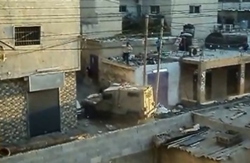 IDF clashes with Palestinians in Kalandiya 370 (photo credit: YouTube Screenshot)