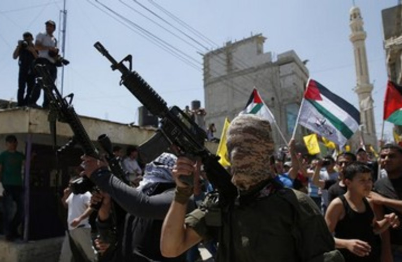 Palestinian militants in Ramallah 370 (photo credit: REUTERS/Darren Whiteside)