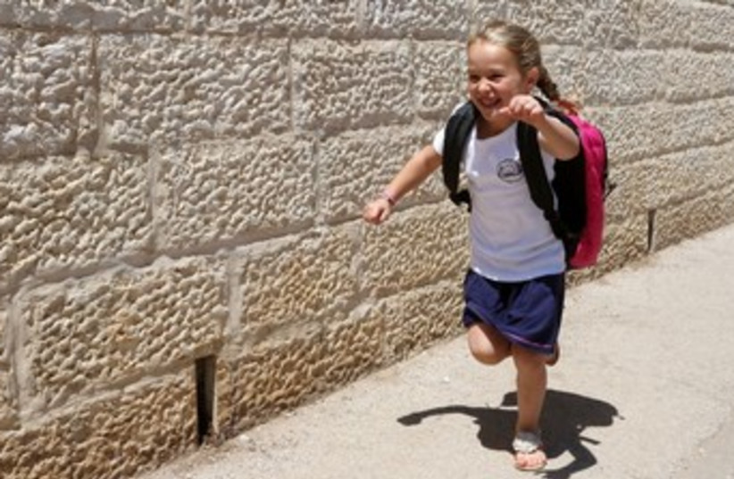 Back to school girl running 370 (photo credit: Marc Israel Sellem/The Jerusalem Post)