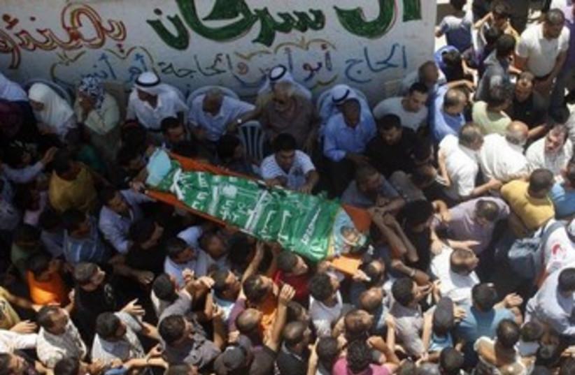 Ibrahim Sarhan Palestinains body Nablus raid funeral 370 (photo credit: Reuters)