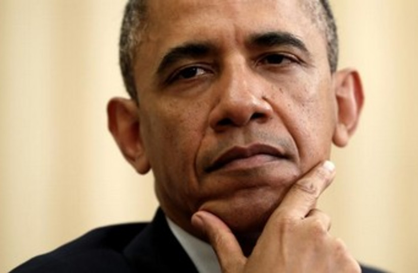 Obama looking serious, thoughful 370 (photo credit: REUTERS/Kevin Lamarque)