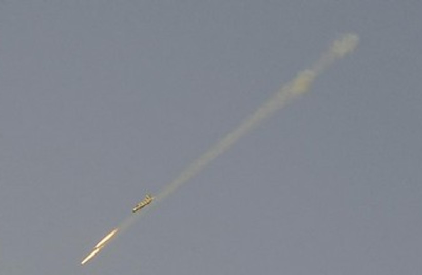 A Syrian Air Force fighter plane fires a rocket (photo credit: Reuters)