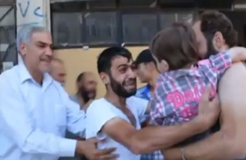 Man reunited with son after chemical weapons  (photo credit: YouTube Screenshot)
