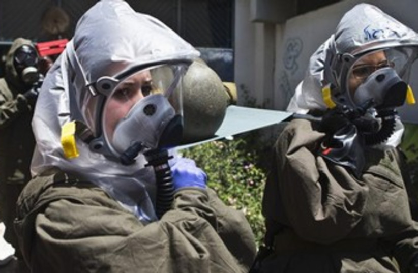 The IDF Home Front Command drills gas a chemical weapons attack against Israel in 2013. (photo credit: REUTERS)