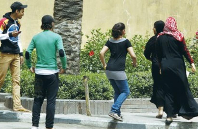 EGYPTIAN MEN harass women 370 (photo credit: REUTERS)