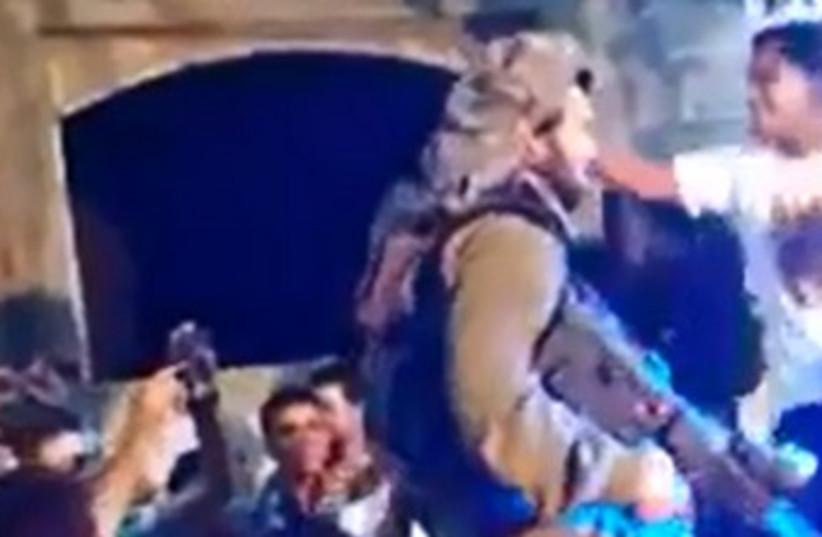 Israeli soldier dancing with Palestinians in Hebron 370 (photo credit: YouTube Screenshot)