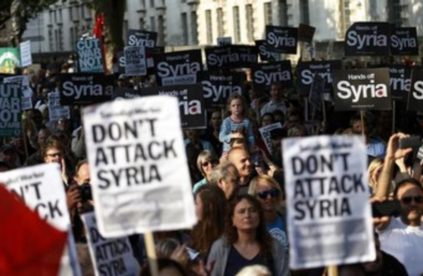 Protest against Syria in London 370 (photo credit: REUTERS/Olivia Harris )