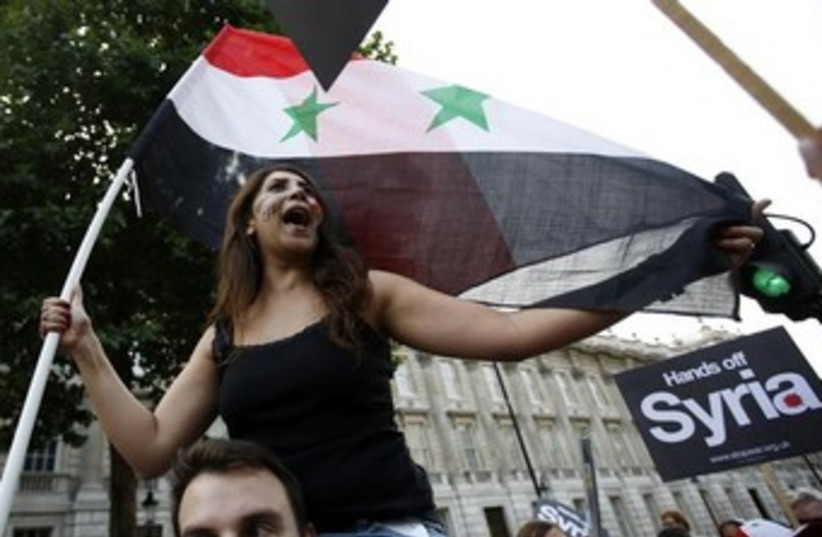 Protest against Syria attack in London 370 (photo credit: REUTERS/Olivia Harris )