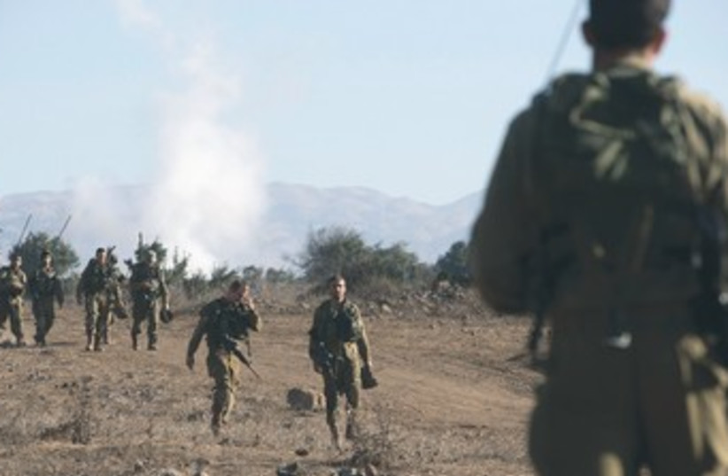 IDF trains on Golan Heights 370 (photo credit: REUTERS)