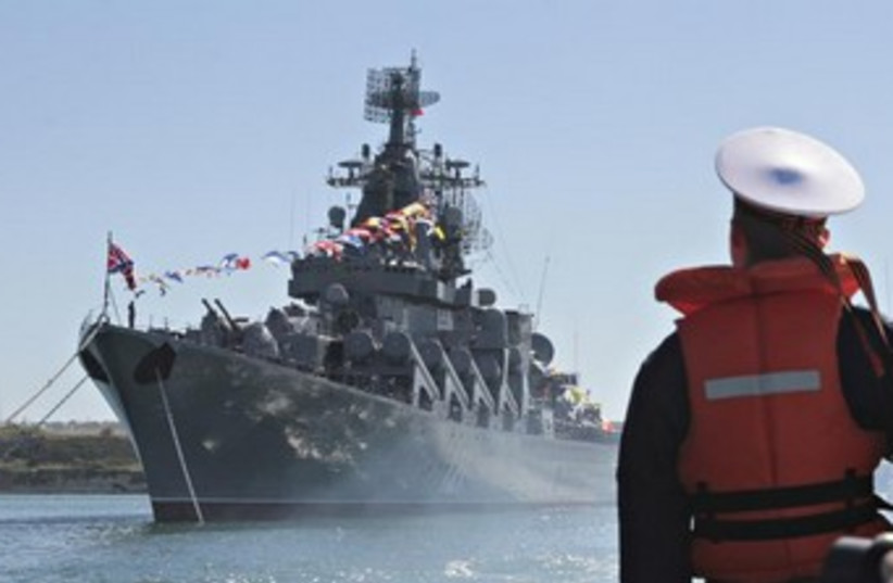 A sailor looks at the Russian missile cruiser Moskva  (photo credit: Reuters)