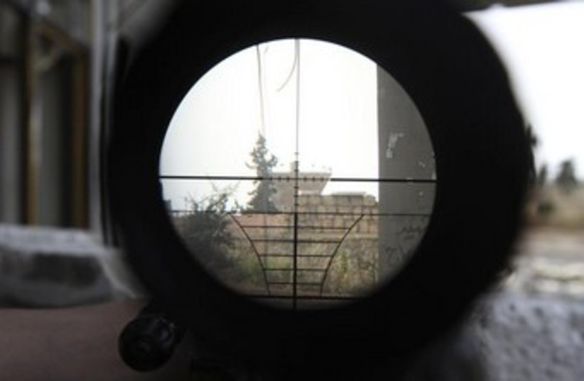 A Syrian regime gathering point is seen through a sniper  (photo credit: Reuters)