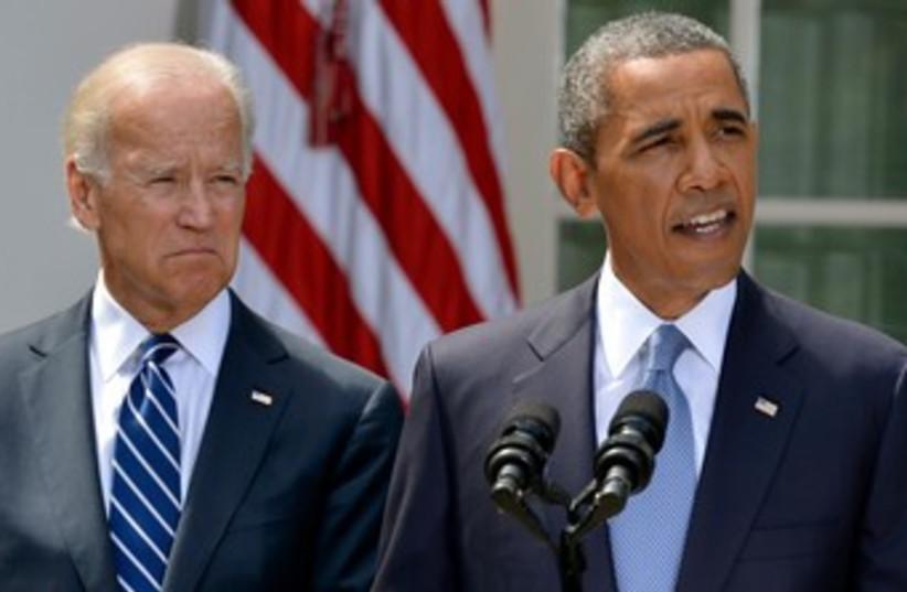Obama Biden talking Syria white house  31.8.13 370 (photo credit: Reuters)