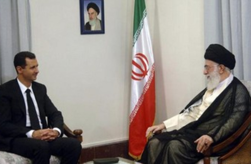 Bashar Assad and Ayatollah Ali Khamenei 370 (photo credit: REUTERS/leader.ir/Handout)