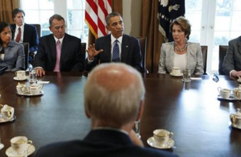 U.S. President Obama (rear C) meets with bipartisan Congress (photo credit: Reuters)