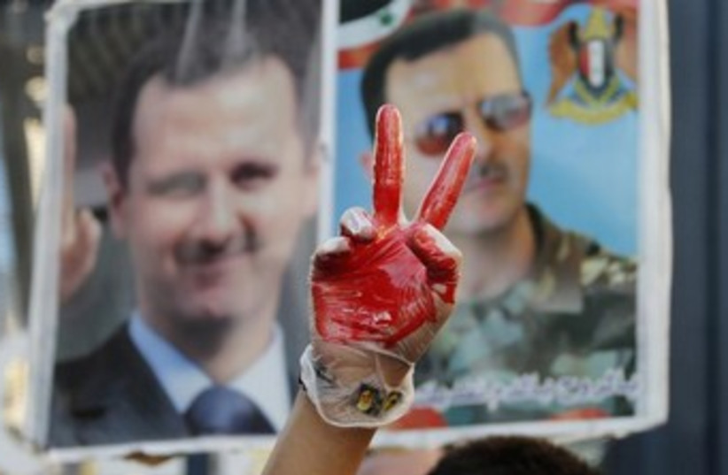 Assad protestors (photo credit: Reuters)
