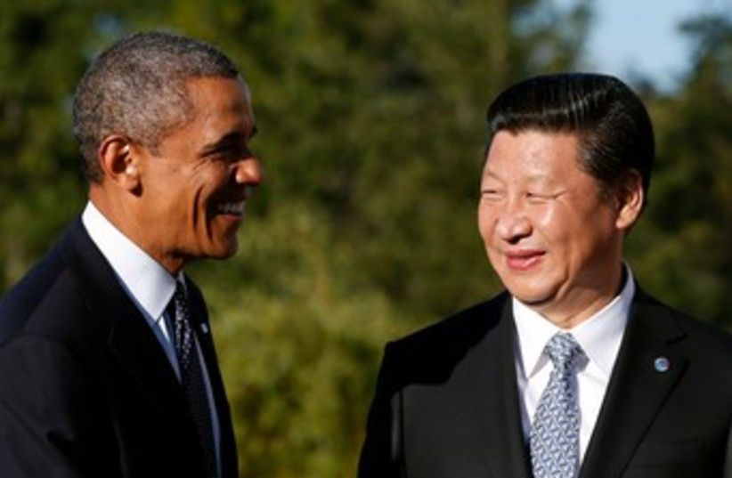 Obama shakes hands with China's President Xi Jinping 370 (photo credit: Reuters)