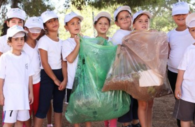 Children clean for World Clean-up Day (photo credit: Dror Artzy)
