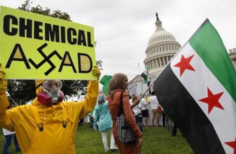 Anti-Assad protesters in Washington 370 (photo credit: REUTERS)