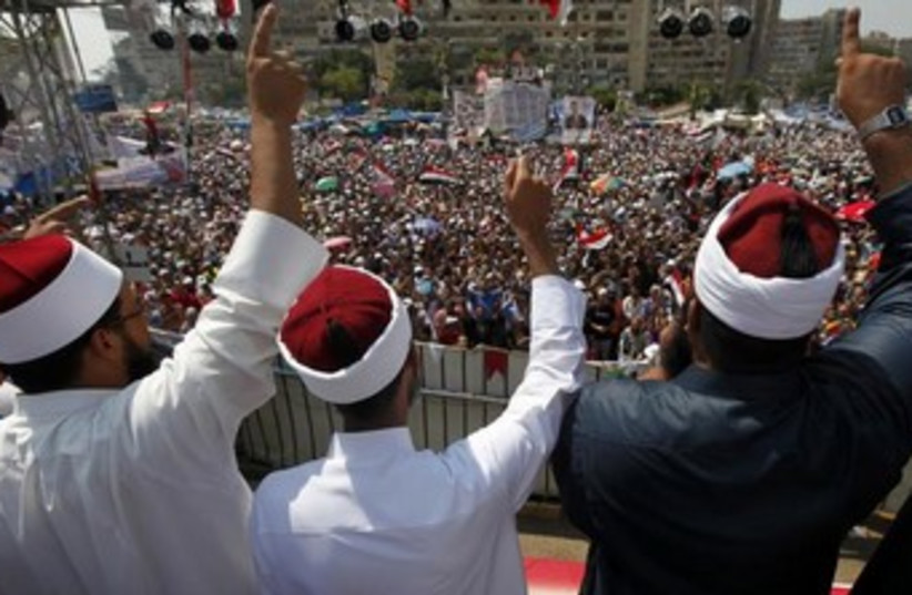Clerics supporting deposed Egyptian President Mohamed Morsi (photo credit: REUTERS)
