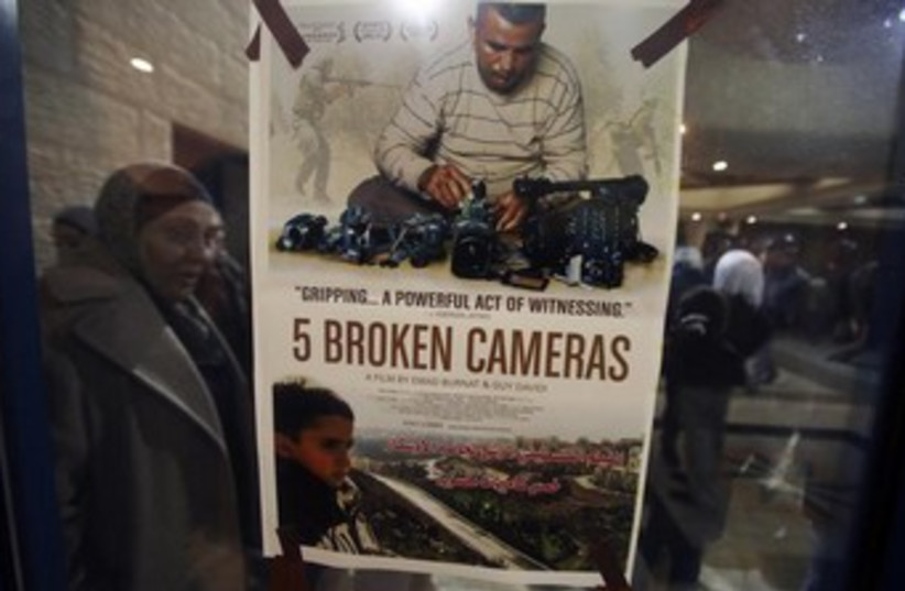 """poster for the Oscar-nominated """"5 Broken Cameras"""" 370 (photo credit: REUTERS)"""