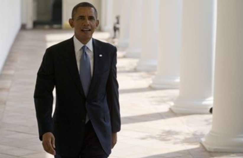 obama walking in white house 370 (photo credit: REUTERS)