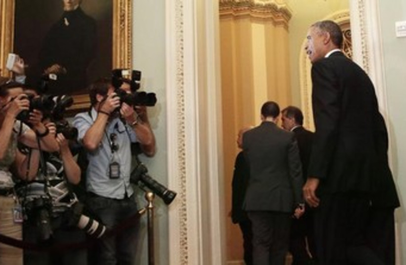 U.S. President Barack Obama leaves a luncheon meeting (photo credit: Reuters)