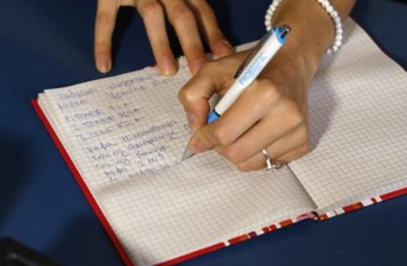hand writing 370 (photo credit: REUTERS)
