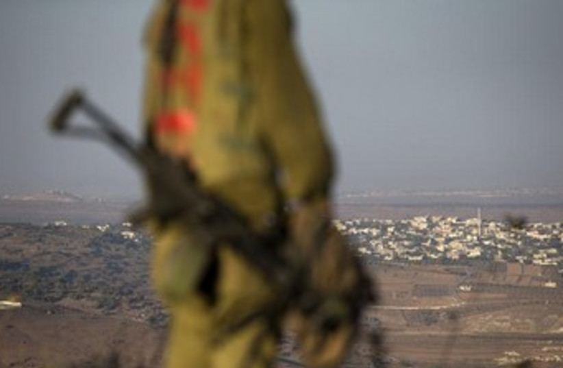 An Israeli soldier on the Golan Heights near Syria border370 (photo credit: Reuters)