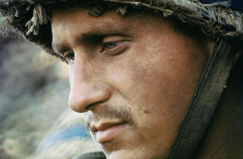 A soldier reflects (photo credit: Micha Bar-Am)