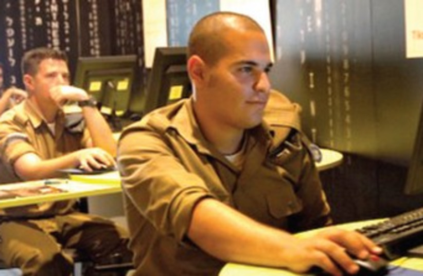 idf soldiers at computer 370 (photo credit: REUTERS)