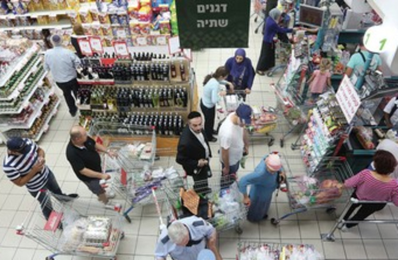 ISRAELIS SHOP at a Jerusalem supermarket. 370 (photo credit: Marc Israel Sellem/The Jerusalem Post)