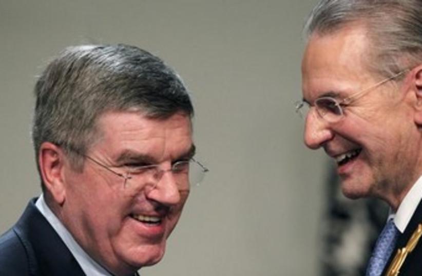 Incoming IOC chief Thomas Bach and Jacques Rogge 370 (photo credit: Reuters)