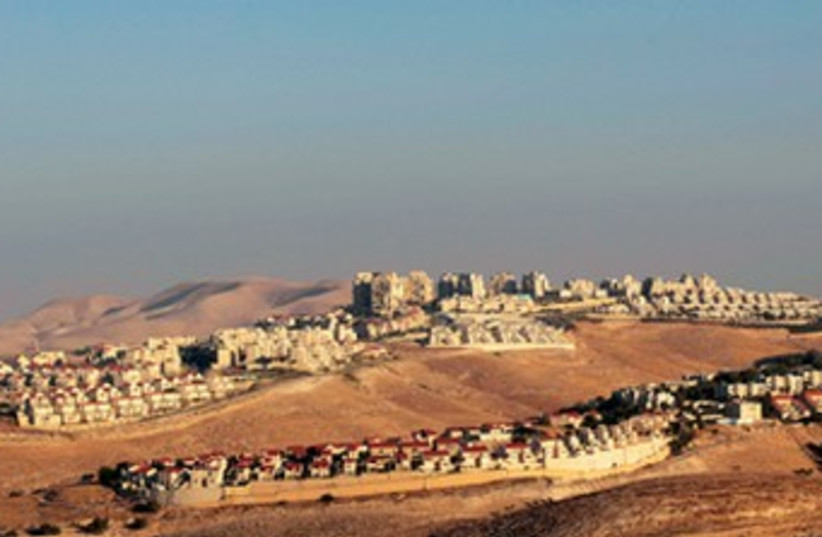 The basic error is to treat all the settlements alike (photo credit: AMMAR AWAD / REUTERS)