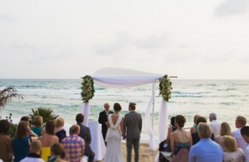 Riina and Esa's beach wedding (photo credit: Bryan Saragosa)