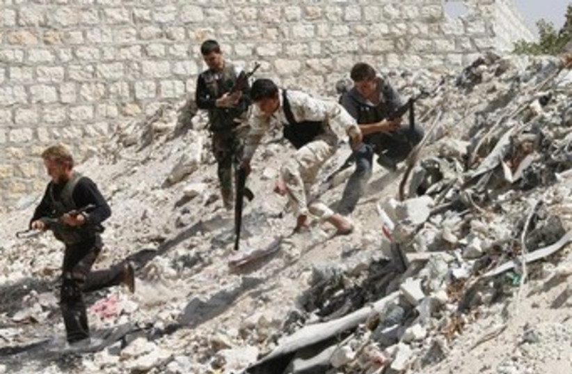 Syrian rebels run to take cover 370 (photo credit: REUTERS)