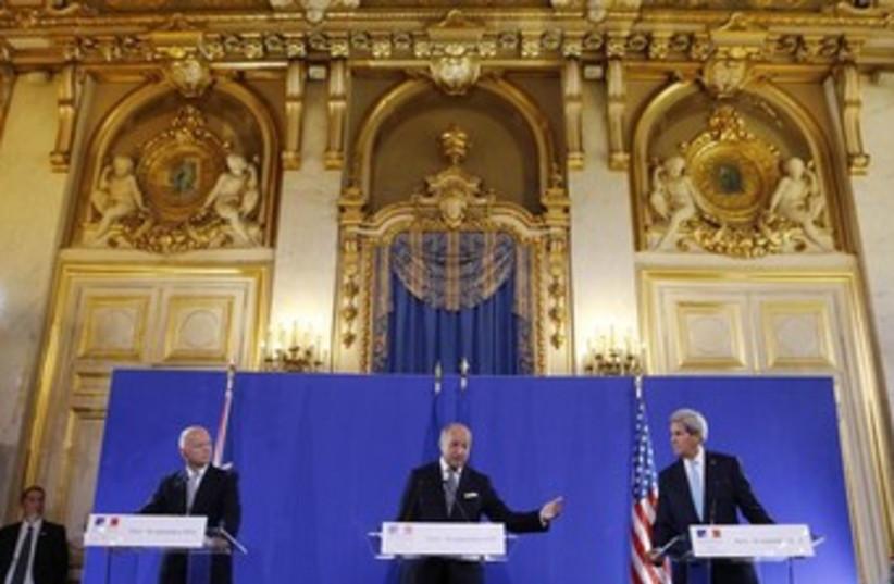 U.S. Secretary of State John Kerry (R) and British FM (photo credit: Reuters)