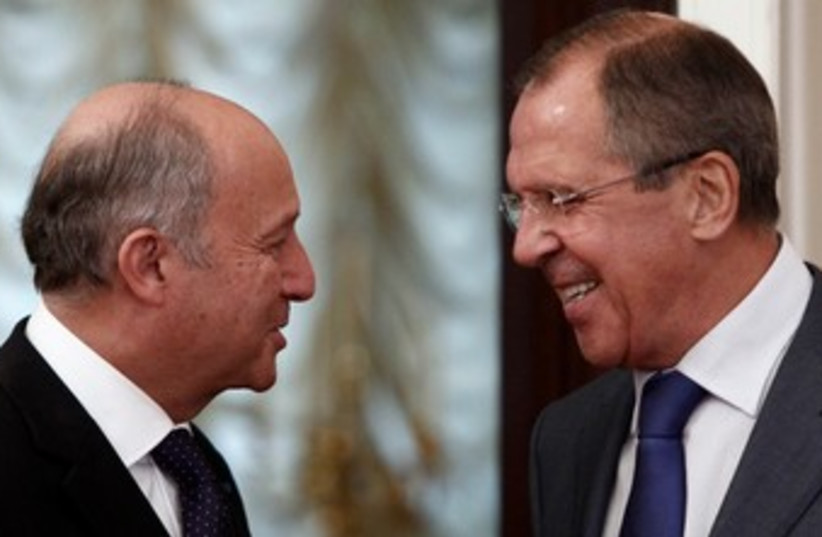 Russian French FMs Moscow 17.9.13 370 (photo credit: Reuters)