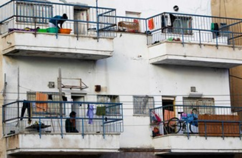 African migrants stand on their balconies 370 (photo credit: REUTERS)