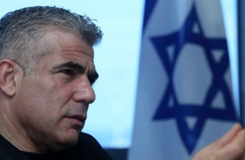 Finance Minister Yair Lapid 370 (photo credit: Marc Israel Sellem/The Jerusalem Post)