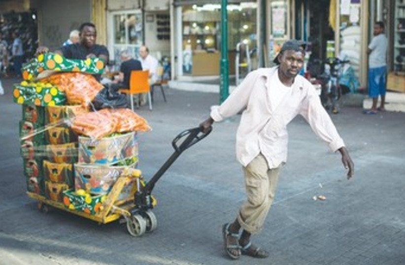 African migrants transport vegetables in south Tel Aviv 370 (photo credit: REUTERS)