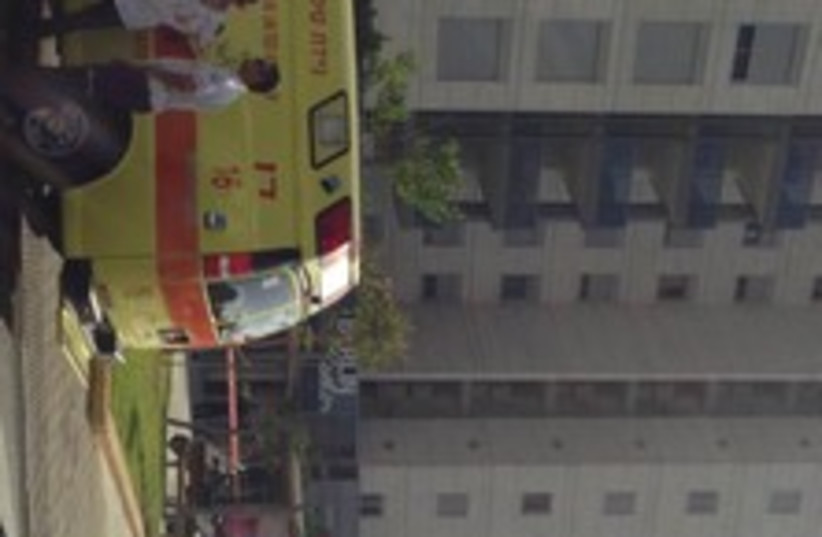 Building where man jumped off with 2 kids 370 (photo credit: Magen David Adom spokesman)