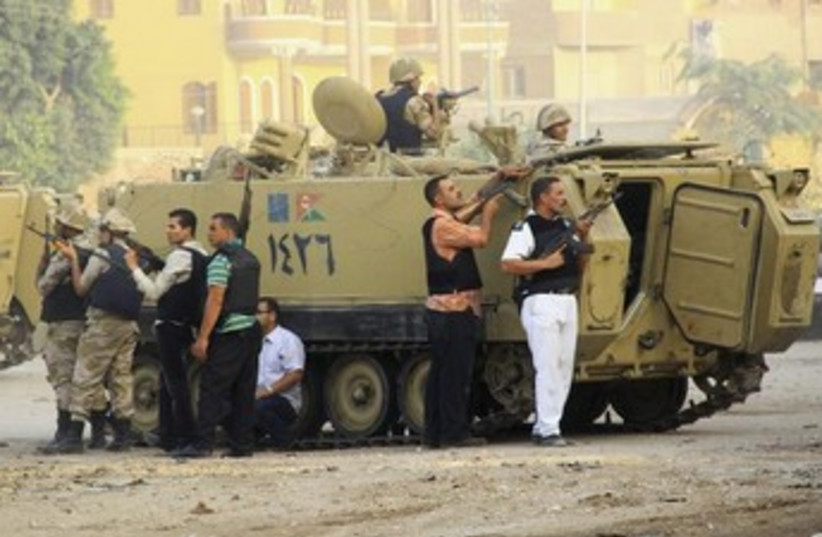 Egyptian security forces at Kerdasa clashes (photo credit: Reuters)