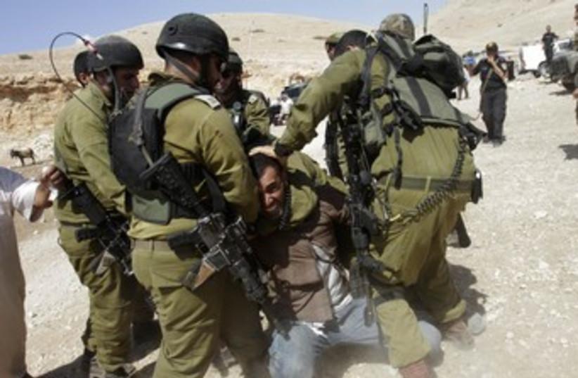 IDF soldiers detain Palestinian in Jordan Valley 370 (photo credit: REUTERS)